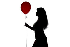 Silhouette of beauty woman with red balloon Stock Images
