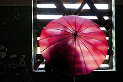 Silhouette behind red umbrella Royalty Free Stock Photos