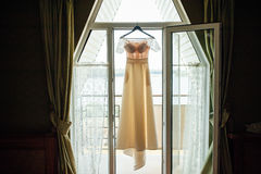 Silhouette of beige lace vintage wedding dress Stock Photos
