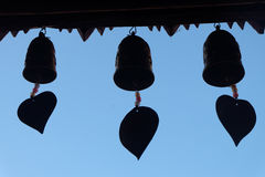 Silhouette of bells at the temple on blue sky. Silhouette of bells at the temple on blue sky Stock Photography