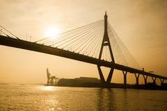 Silhouette of bhumibol suspension bridge crossing chaopraya rive Stock Photos