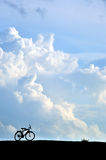 Silhouette of bicycle. Silhouette of bicycle with cloud and blue sky Royalty Free Stock Images