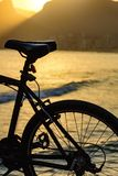 Silhouette of bicycle in front of the beach Royalty Free Stock Photo