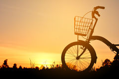 Silhouette of bicycle on grass Stock Image