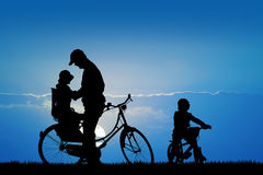 Silhouette of bicycle people Stock Image