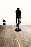 Silhouette of a bicycle rider Stock Images