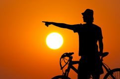 Silhouette of the bicycle rider at sunset Stock Images