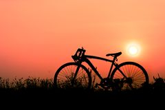 Silhouette a bicycle. Silhouette of a bicycle on sunset background. space for text Royalty Free Stock Photography