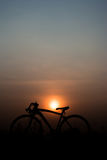 Silhouette a bicycle. Silhouette of a bicycle on sunset background. space for text Stock Photography