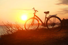 Silhouette of a bicycle at sunset Royalty Free Stock Photography