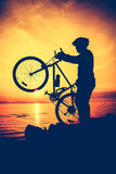 Silhouette of bicyclist enjoying the view at seaside. Outdoors. Stock Photography
