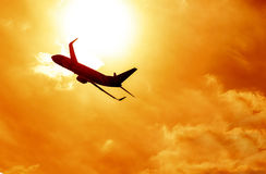 Airplane silhouette on sunset background Royalty Free Stock Photos