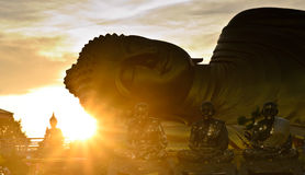 Silhouette of big Buddha statue over sunrise at Songkhla, Thaila Royalty Free Stock Photos