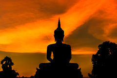 Silhouette big buddha statue sitting on sunset Royalty Free Stock Photos