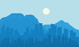 Silhouette of big city and moon Stock Images