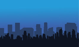 Silhouette of big city at night Stock Images