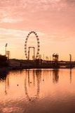 Silhouette of big ferris wheel in pink sky Royalty Free Stock Photos
