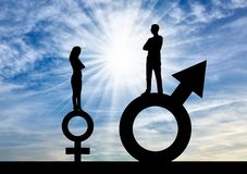 Silhouette of a big man and a small woman standing on gender symbols. Stock Photos
