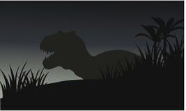 Silhouette of big tyranosaurus with grass Royalty Free Stock Image