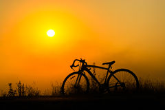 Silhouette of a bike. Silhouette of bicycle on background sunset Royalty Free Stock Images