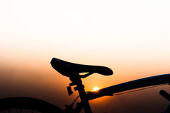 Silhouette of a bike. Silhouette bicycle on sunset background Stock Photography