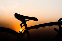 Silhouette of a bike. Silhouette bicycle on sunset background Royalty Free Stock Image