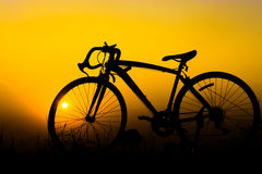 Silhouette of a bike. Silhouette of a bicycle on yellow sunset background Royalty Free Stock Photo
