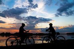 Silhouette bike girl at sunset Stock Images