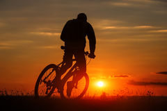 Silhouette of a bike on sky background during sunset Royalty Free Stock Images