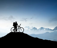 Silhouette of a bike tourist Stock Photography