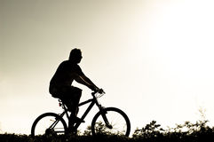 Silhouette of biker Royalty Free Stock Images