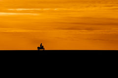 Silhouette of biker Stock Photography