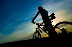 Silhouette of biker. On sunrise Stock Images