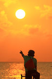 Silhouette of a biker on the beach. Point to sunset stock images