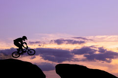 Silhouette of the biker on a bicycle in a jump Stock Images