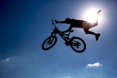 Silhouette biker blue sky Stock Photography