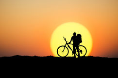 Silhouette of a biker Stock Photos