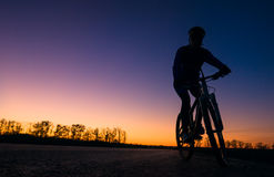 Silhouette of biker. A silhouette of biker at sunset Stock Image