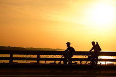 Silhouette of the biker on in sunset Royalty Free Stock Photography