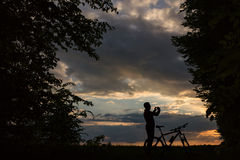 Silhouette of biker at sunset Royalty Free Stock Image