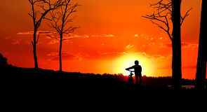 Silhouette of a biker Royalty Free Stock Images