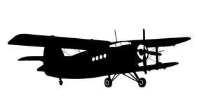 Silhouette of a biplane. Silhouette of an old biplane on the landing field Royalty Free Illustration