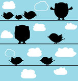Silhouette of birds owl on a wire with clouds Royalty Free Stock Photos
