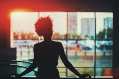 Silhouette of black curly girl in front of window Royalty Free Stock Photo