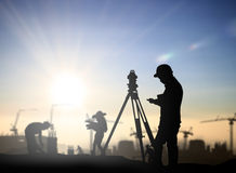 Silhouette black man survey and civil engineer stand on ground w Stock Image