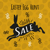 Silhouette of a black rabbit with a handwritten sale easter egg Stock Photography