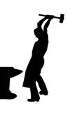 Silhouette of blacksmith with hammer in hand Royalty Free Stock Images