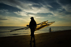 Silhouette of bleary fisherman. In the morning, there are two fishermen looked bleary which is their main source of livelihood Royalty Free Stock Image