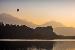 Silhouette of Bled Castle on a Lake Stock Photography