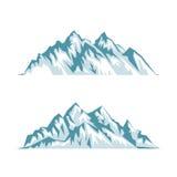 Silhouette bleue des montagnes avec des ombres, des lumières et la neige Images libres de droits